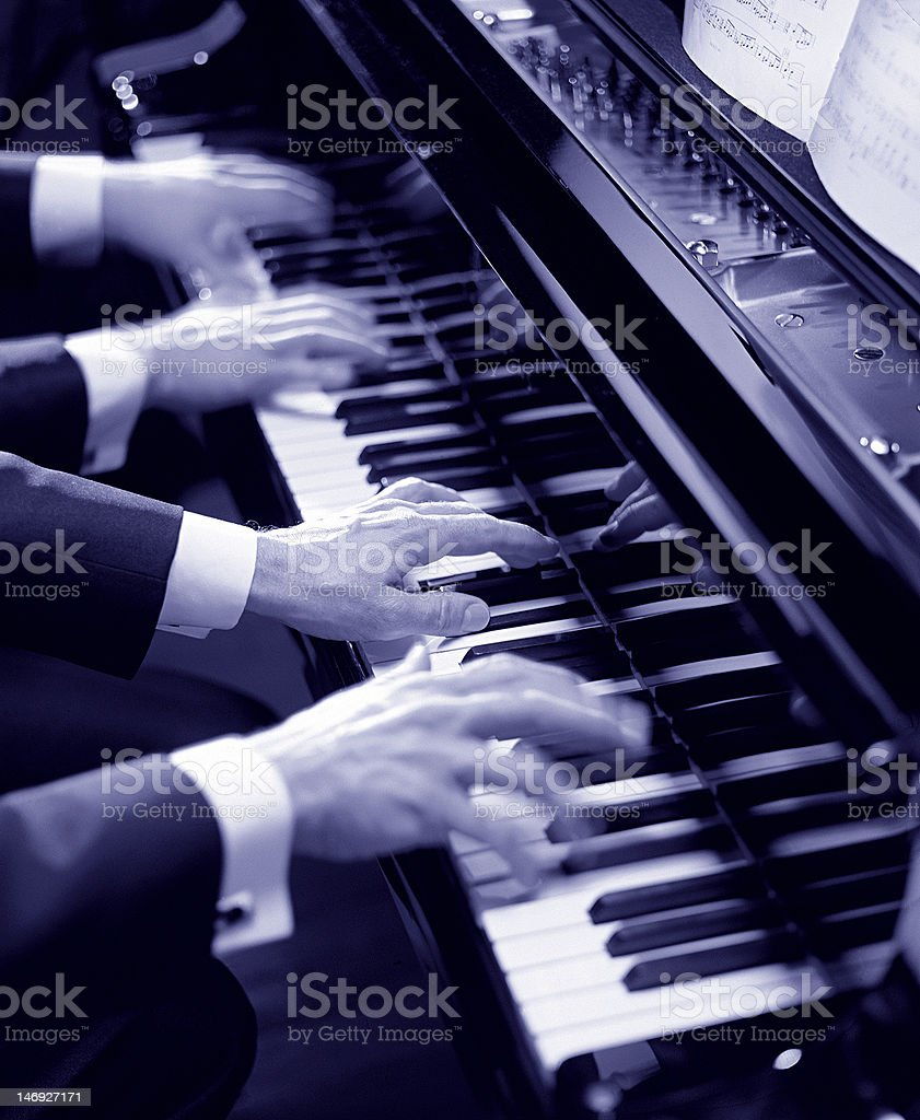 Hands playing the piano stock photo