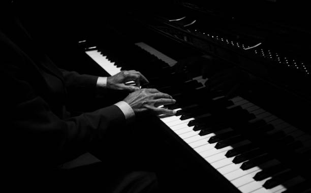 Hands playing the piano Hands playing the piano keyboard player stock pictures, royalty-free photos & images