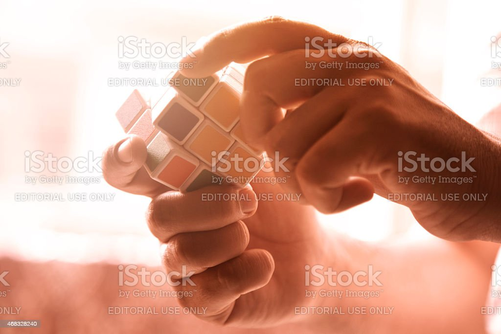 Hands playing with colors cube stock photo