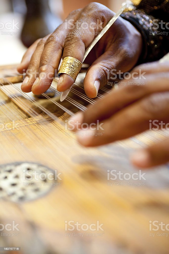 Hands playing Zither, Moroccan Guitar stock photo