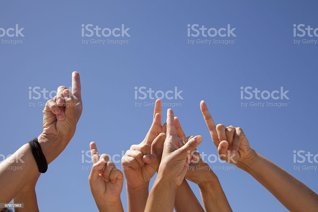 hands pointing to the sky royalty-free stock photo