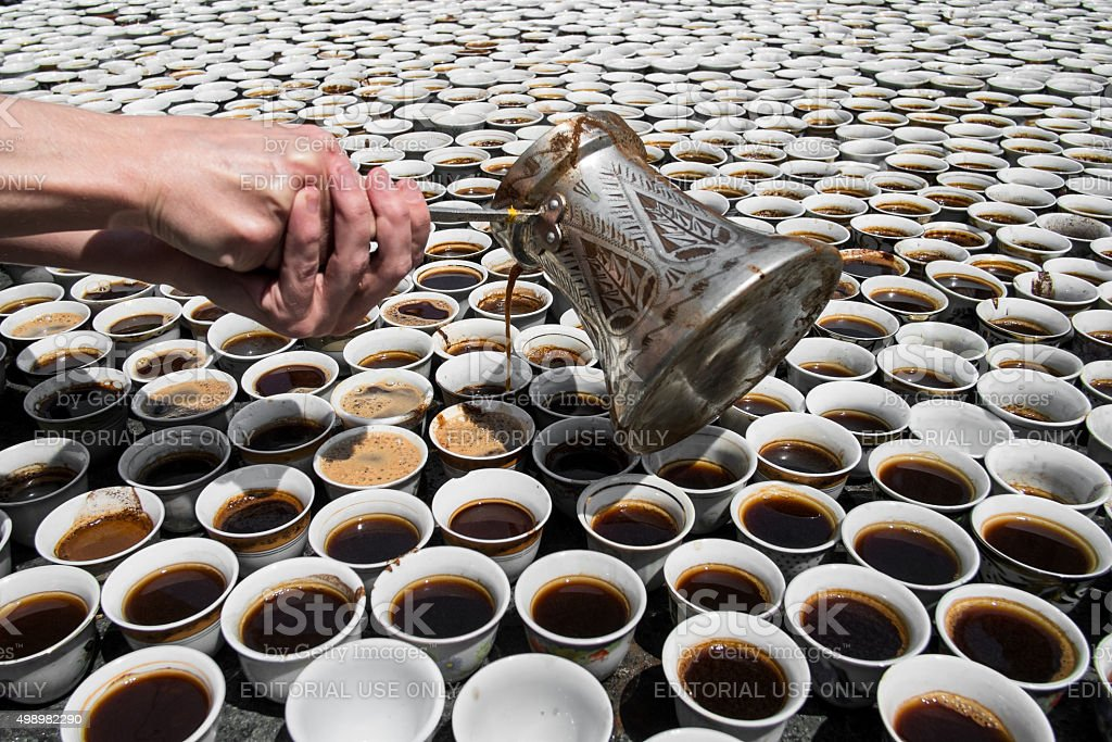Hands Pouring Bosnian Coffee - Anniversary Srebrenica Genocide stock photo
