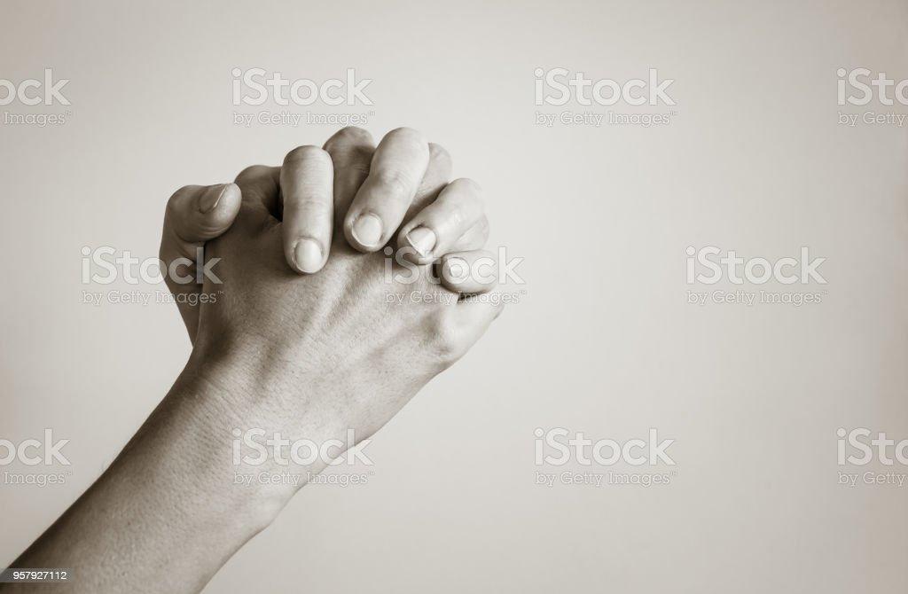 Hands praying stock photo