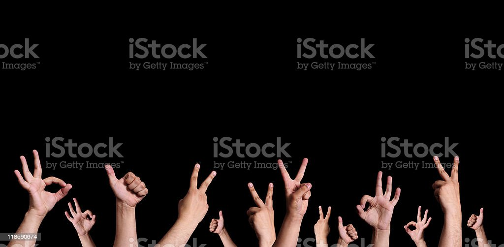 Hands preforming sign language on a black background stock photo