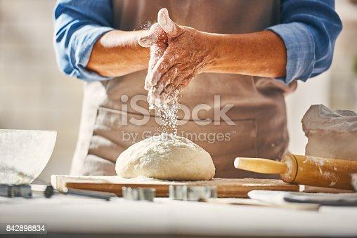istock Hands preparing dough 842898834