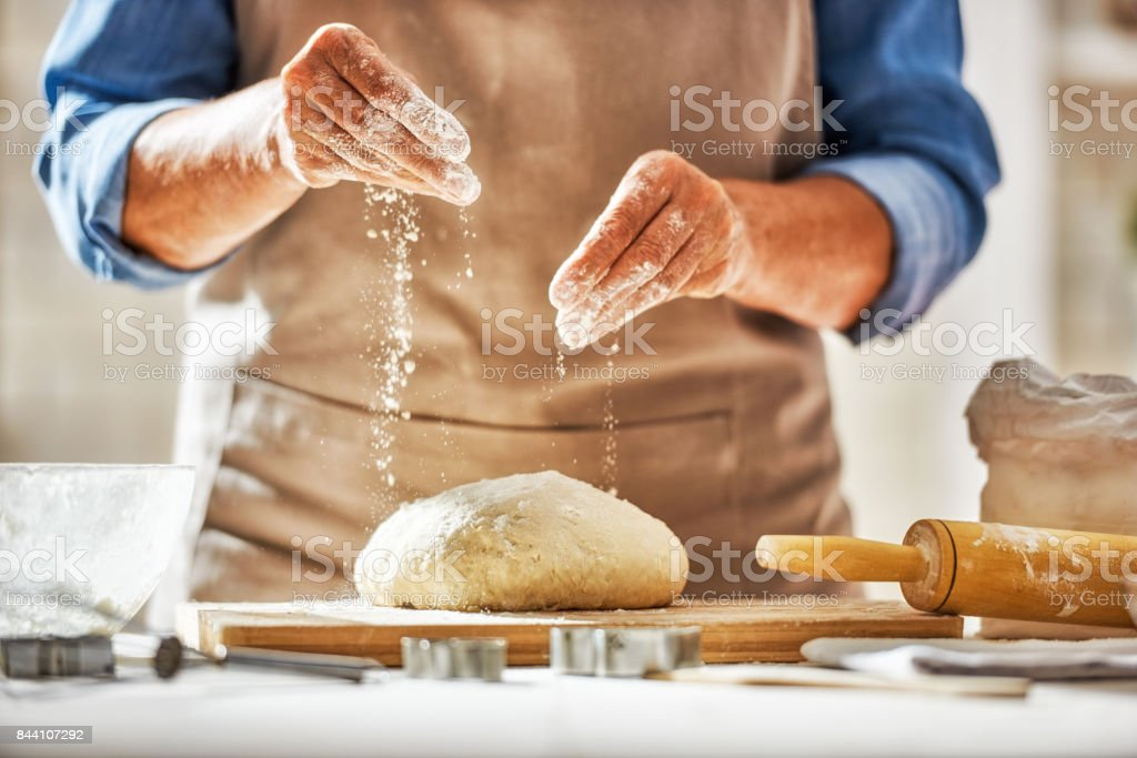 Hands preparing dough stock photo