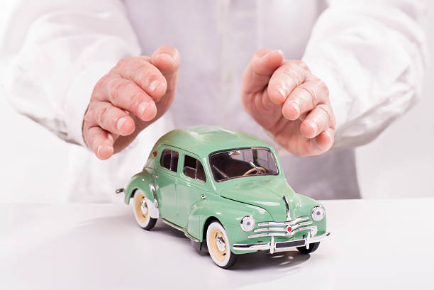 Hands protecting a car stock photo