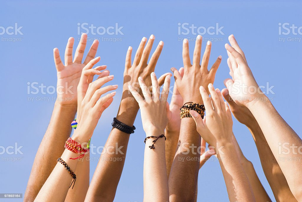 Hands raised to the sky royalty-free stock photo