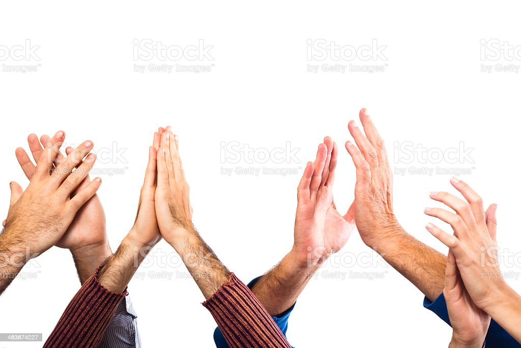 Hands Raised Up Clapping on White Background stock photo