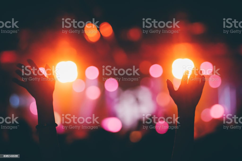 Hands raised up on a concert stock photo
