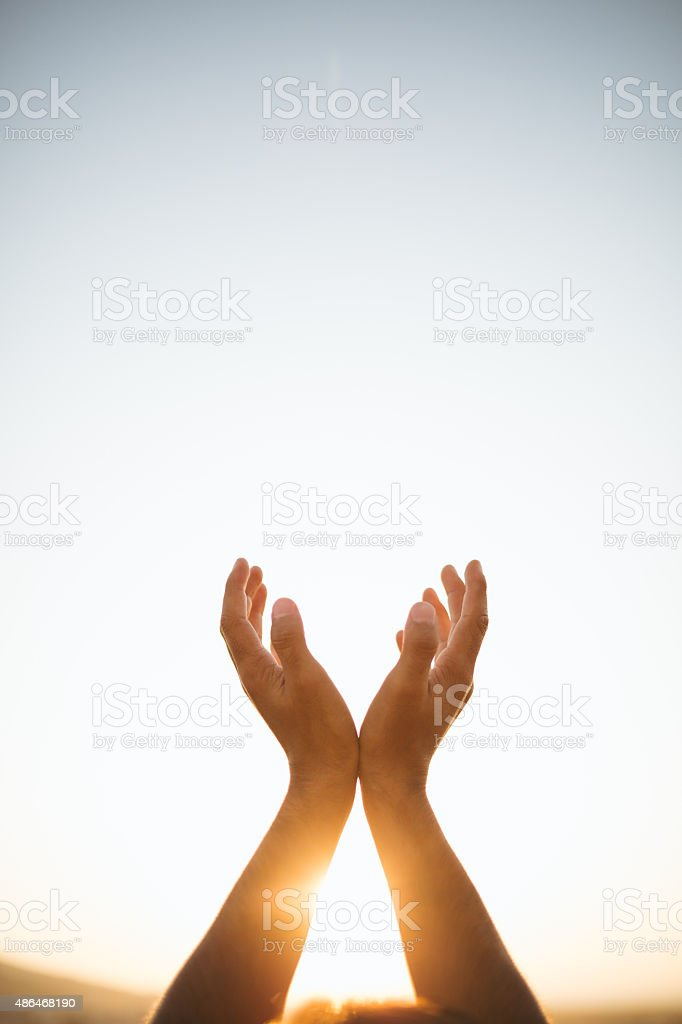 Hands raised up stock photo