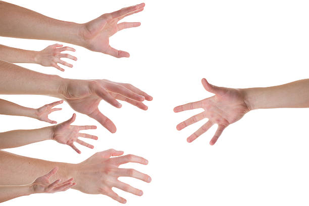 hands reaching for a helping hand - cursed stock pictures, royalty-free photos & images