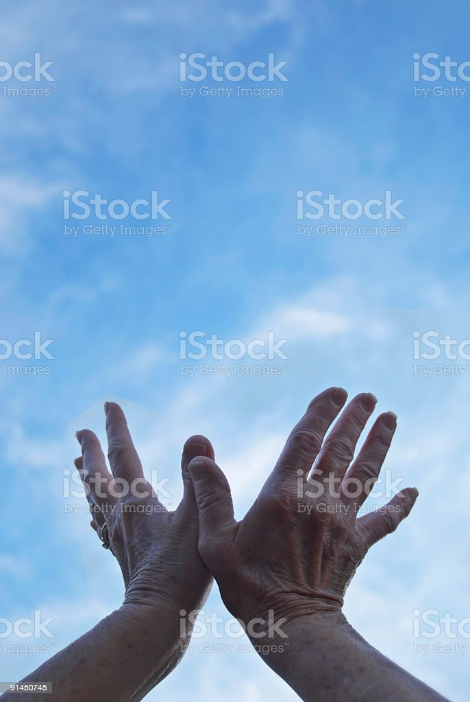 hands reaching into sky royalty-free stock photo