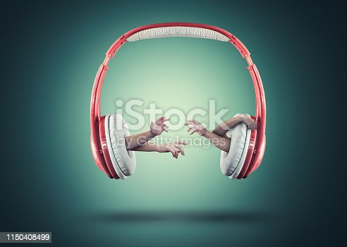 Hands reaching out of headphones.