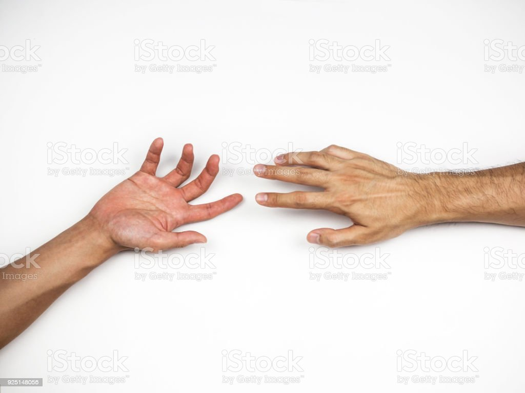 Hands reaching to each other on white background stock photo