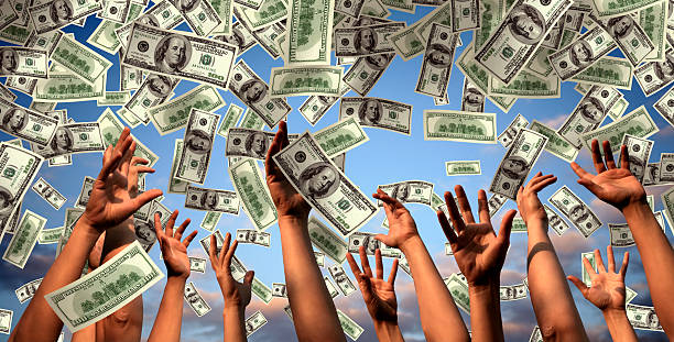 hands reaching to falling money Hands reaching to falling money. lottery stock pictures, royalty-free photos & images