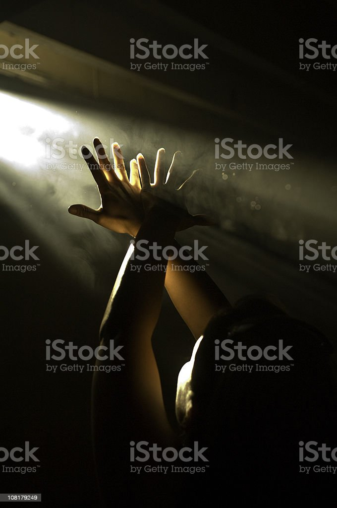 Hands Reaching Up to Ray of Light royalty-free stock photo