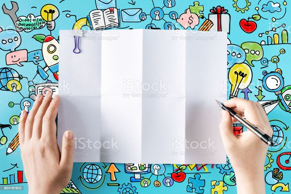Hands ready to draw on a blank sheet of paper stock photo