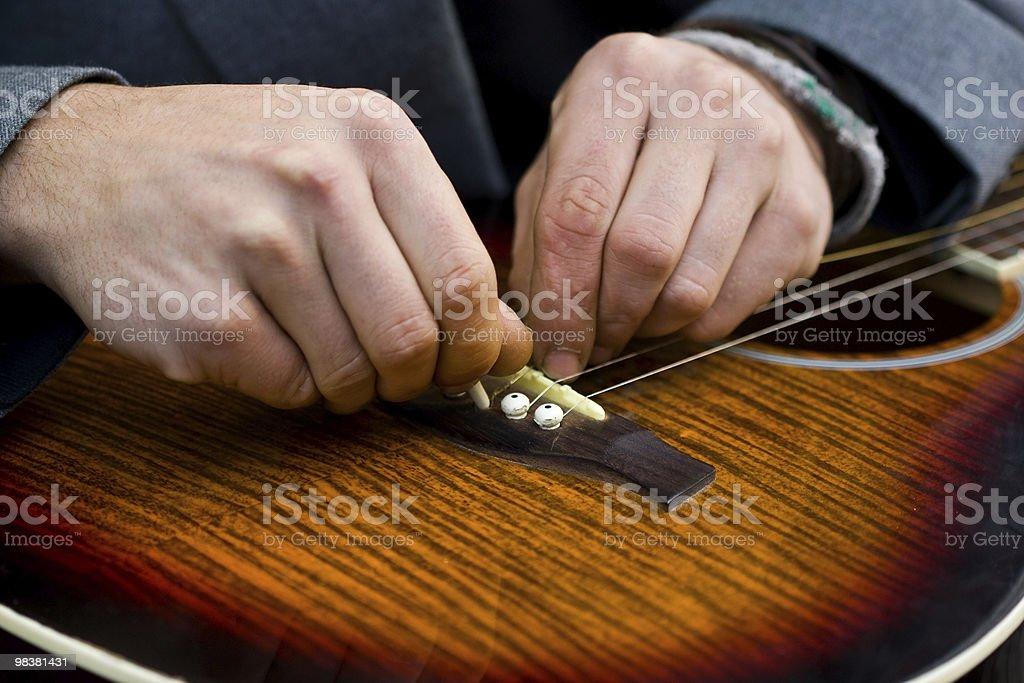 Hands repairing strings royalty-free stock photo