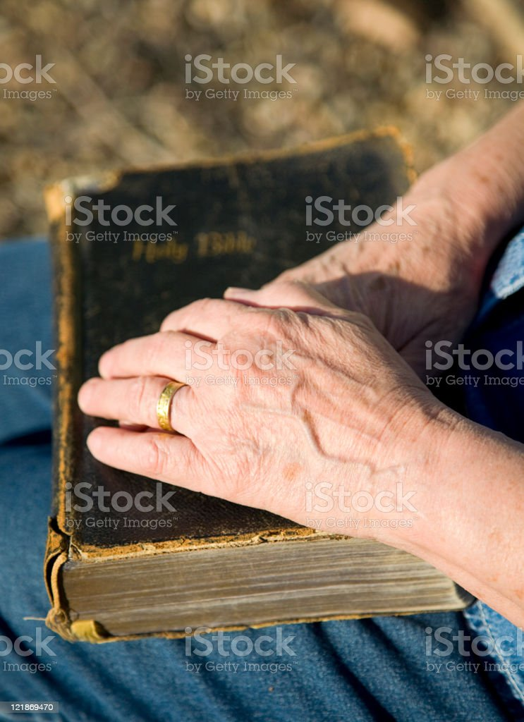 Hands Resting on Bible royalty-free stock photo
