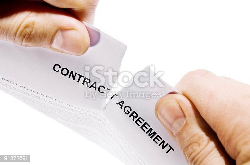 istock Hands ripping contract agreement document 91372591