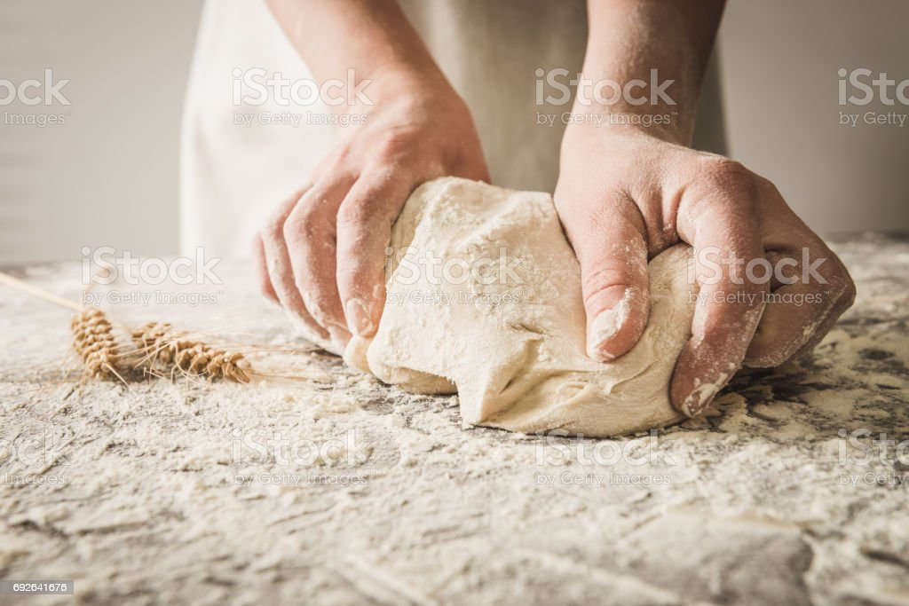 hands rumple dough stock photo