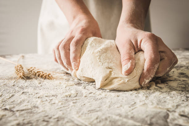 hands rumple dough Dough,hands,dough yeast stock pictures, royalty-free photos & images