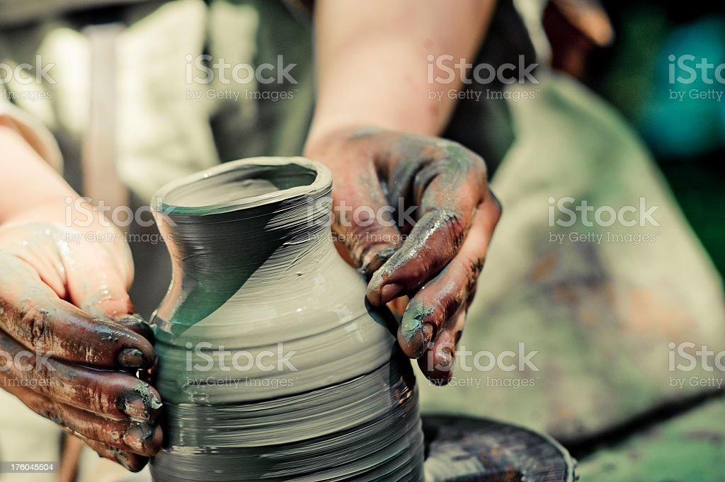 Hands sculpting pottery jug out of clay royalty-free stock photo