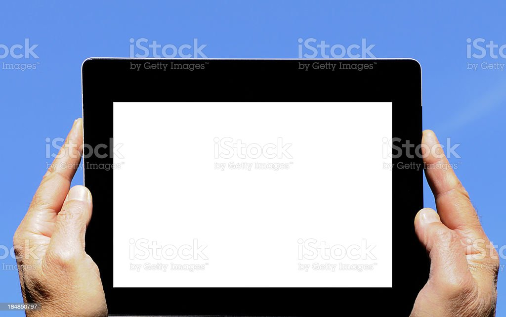Hands Showing Blank Digital Tablet Blue Sky royalty-free stock photo