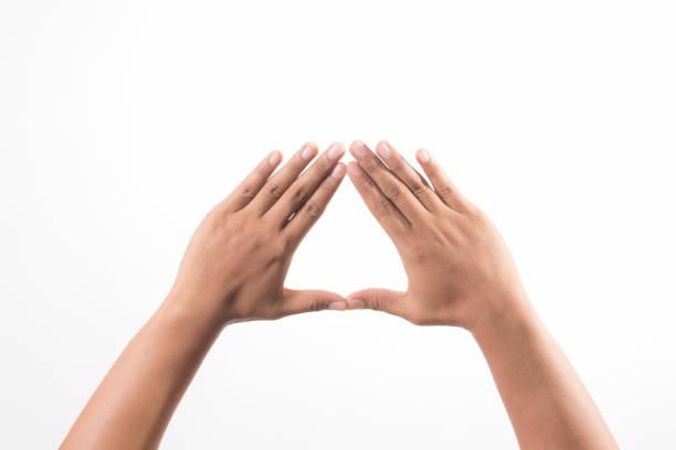 hands showing the triangle sign - mano donna dita unite foto e immagini stock