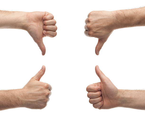 hands showing thumbs up and down - thumbs down stock photos and pictures