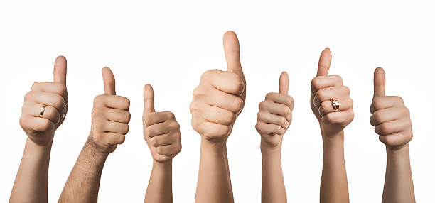 Hands showing thumbs up stock photo