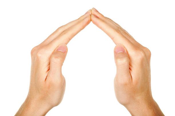 Hände mit Dreieck-Symbol – Foto