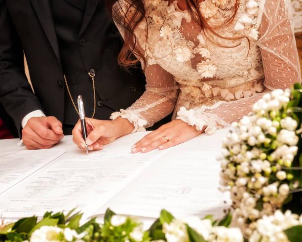 hands signing during the wedding - mano donna dita unite foto e immagini stock
