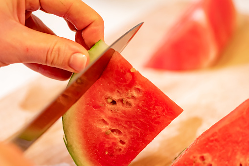 Hands Slicing Watermelon