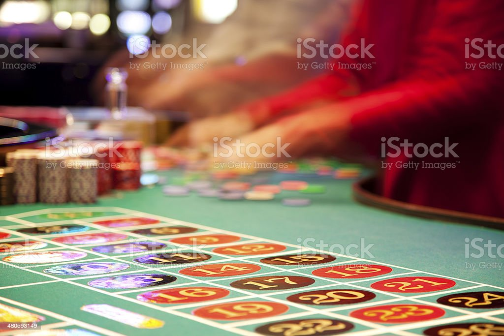 Hands sorting chips at the roulette table in casino royalty-free stock photo