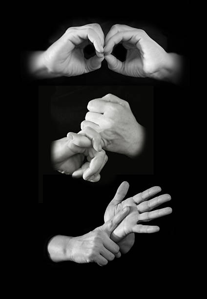 Hands spelling out BSL in British sign language stock photo