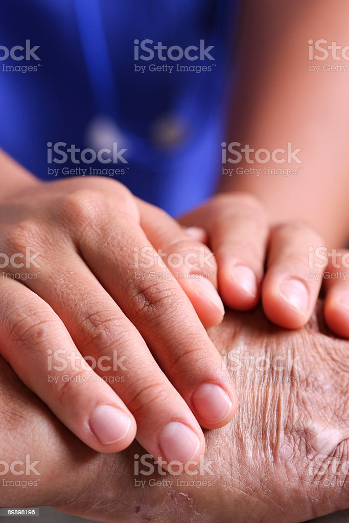 Hands taking care royalty-free stock photo