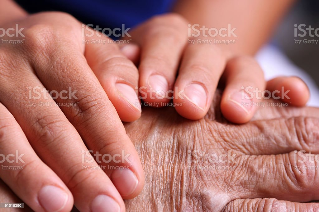 hands taking care stock photo