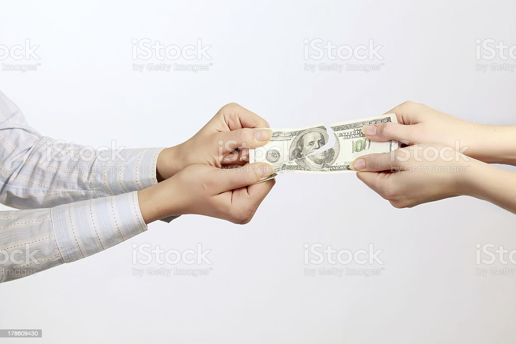 Hands tear money isolated on white background stock photo