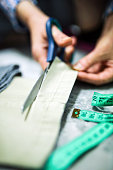istock Hands That Measure and Cut Trouser Fabric With Tailor, Craft, Scissors and Tape Measure 1278060386