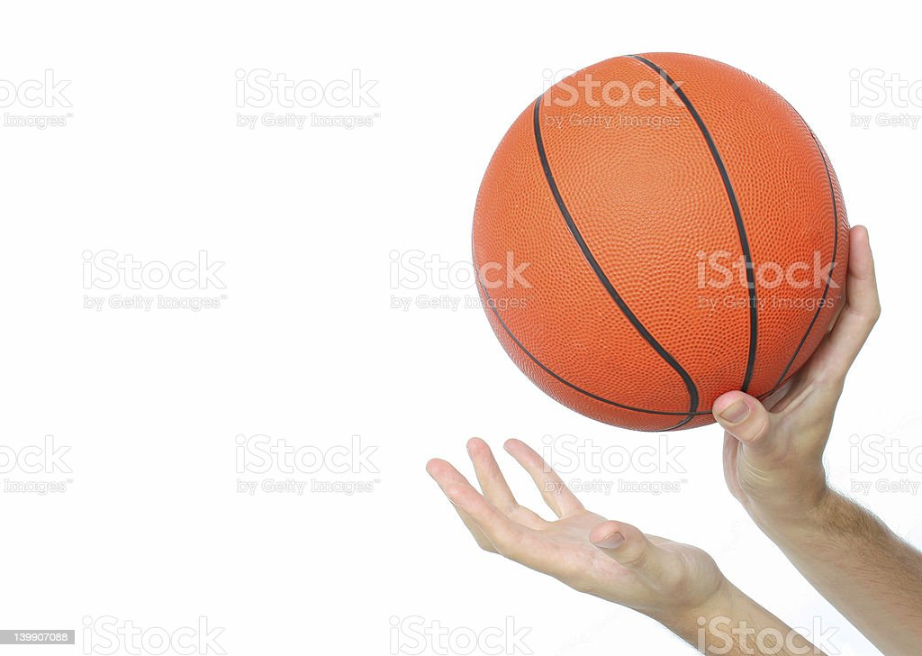 Hands throwing or catching a basketball ball isolated royalty-free stock photo