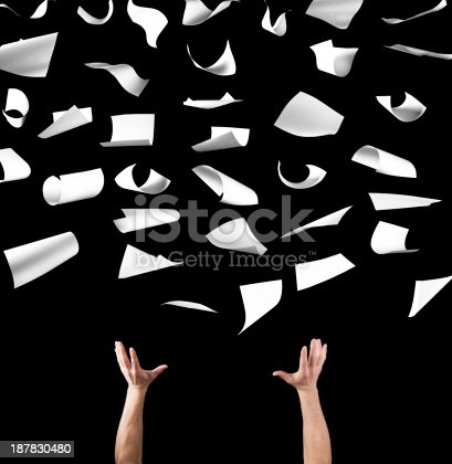 462138083 istock photo Hands throwing papers into a black background 187830480