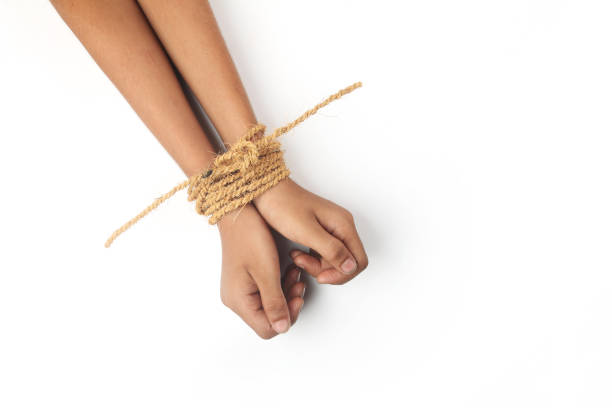 hands tied by strong rope - boy handcuffs stock pictures, royalty-free photos & images