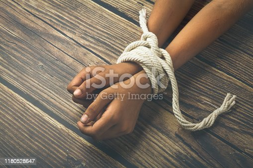 Hands tied by strong rope