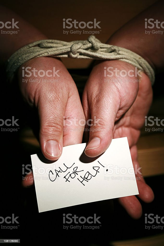 hands tied up holding call for help card royalty-free stock photo