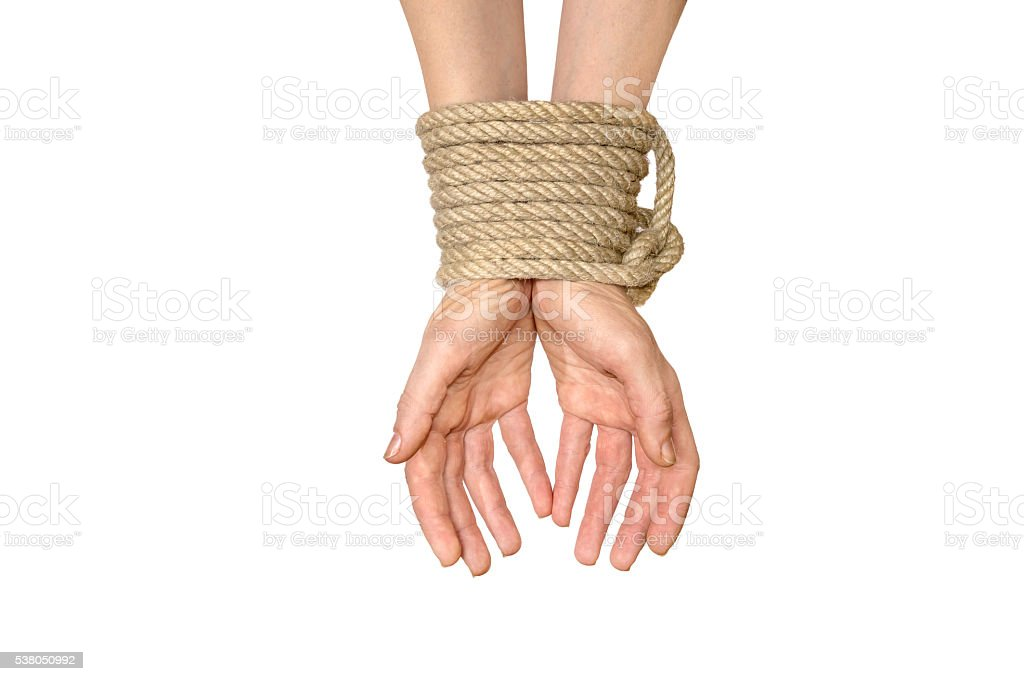 Hands tied with rope isolated on white stock photo