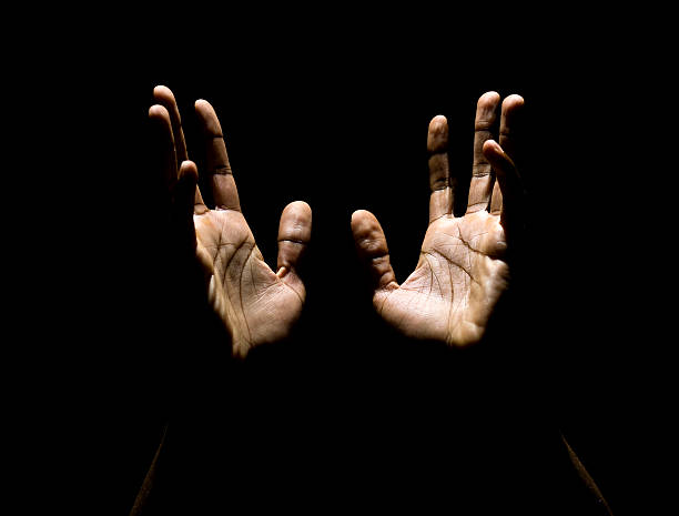 hands to heaven - praise and worship stock photos and pictures