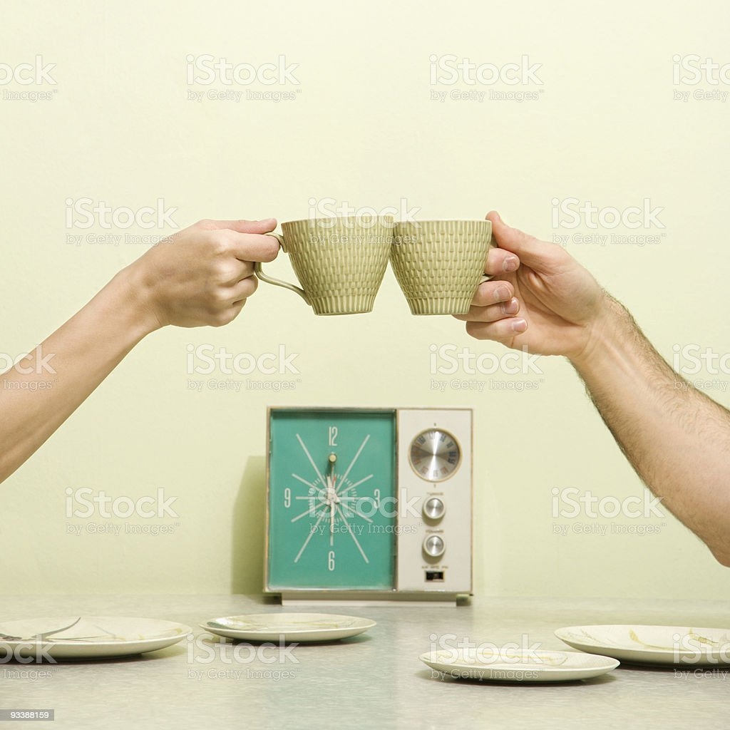 Hands toasting with cups. stock photo