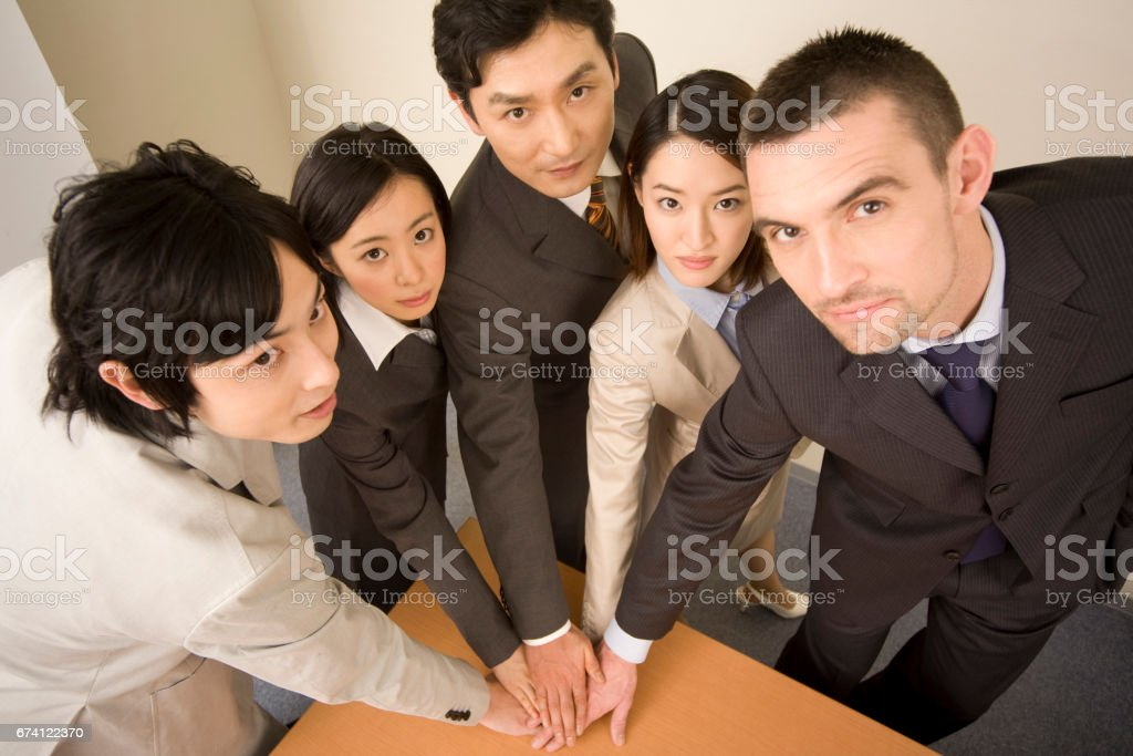 Hands together businessmen from five royalty-free stock photo